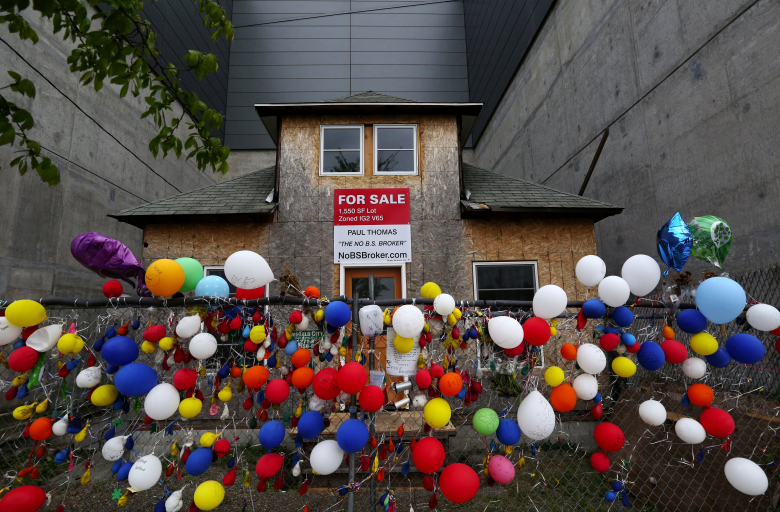 Edith Macefield's vacant home in Ballard will soon have a new owner.  The late owner's to sell resonates with people who have left this celebration and memorial to her.  Thursday March 23, 2015.